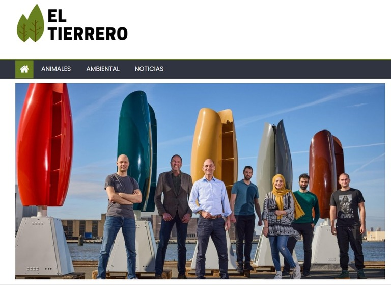 A group of people standing in front of surfboards  Description automatically generated with medium confidence