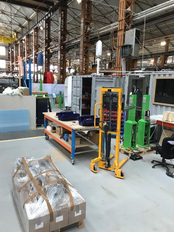 A picture containing indoor, factory  Description automatically generated